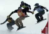 (Aspen, Colo., January 30, 2005) Xavier de la Rue, of France, foreground center, leads Marco...