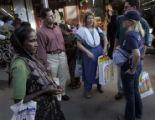(1/16/05,Chennai, India)  A woman begs from Dr. Pat Railey, Nanci Ricks, Greg Gustafson, and...