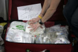 (1/16/05,Chennai, India)   Courtney Shepherd repacks IV supplies at the Breeze Hotel. The Dalit...