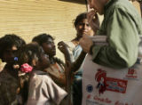 (1/16/05,Chennai, India)   Dave Hoffman, from Atlanta, interacts with street children in Chennai. ...