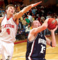 (GREELEY, COLO., December 3, 2004) Northridge High School senior Billy Mansfield goes up for a...