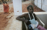 (1/17/05,Kaalapet, India)   S. Raja waits patiently for an injection at the OM Medical Camp in...