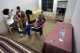 (1/17/05,Kaalapet, India)   Kitty Potter, Helen Parton, and Cheryl Bencala debrief each other...