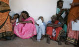 (1/17/05,Kaalapet, India) Tired women wait in line to see the doctor at the medical camp.  The...