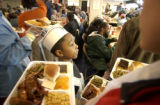 [(Denver, CO, Shot on: 1/17/05)]  Volunteer Ade Meeks, 8, (CQ) (CENTER) serves the needy at the...