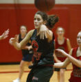 Lisa Mallen makes a blind pass during drills at girls varsity basketball practice in Fairview High...