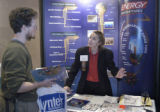 Denver, CO 02/01/05 Sheryl Garling (right) of Energy Laboratories Inc.of Casper, WY explains the...