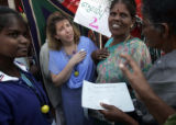 (1/18/05, Singarathoppu , India)   Nanci Ricks talks with women waiting to see her in the physical...
