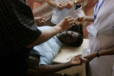 (1/18/05, Singarathoppu , India)   A patient is prepped for surgery to take out a fatty tumor from...