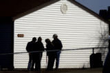 Aurora, Colo.-January 19,2005- Aurora Police investigators at the scene of a double homicide at...