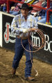 (Denver, Colo., 1/19/05- David Moteswalks out of the arena after competing in the team roping...