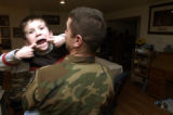 (PEYTON,  Colo., January 28, 2005) In a light hearted moment, Ian Hunt,6, tries to show a visitor...