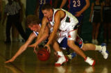 (Aurora,Colo.- Photo taken Feb. 4, 2005) -  Cherry Creek's Mark Traina (left) gets tripped up by...