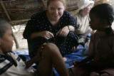 (1/22/05, Pudukkuppam, India)  Kaylin Shaw, 18, communicates with two orphans who lost their...