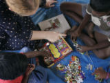 (1/22/05, Pudukkuppam, India)  Kaylin Shaw, 18, plays with orphans who lost their parents in the...