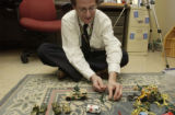 (FORT CARSON, Colo., February 1, 2005) Doug Lehman here sets up his side of army men demonstrating...