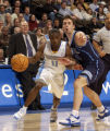 (Denver, Co., Feb. 8,2005) Earl Boykins drives past Utah's Raul Lopez in second half action at the...