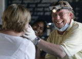 (1/25/05, Pondicherry, India)  Rick Kitchen cracks up before seeing his next patient.  His...