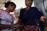 (1/25/05, Pondicherry, India)  Nurse Practitioner Lee Mayer supervising the moving of a very sick...