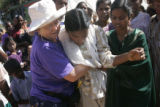 (1/25/05, Pondicherry, India)  Jewel Wigs, 64, helps a girl who fainted in line waiting to see Lee...