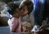 (1/25/05, Pondicherry, India)  Theresa Thurman gives 7-year-old dental patient Monisha a kiss on...