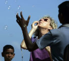 (1/25/05, Pondicherry, India)  Cheryl Bencala blows bubbles for the village children to chase on...