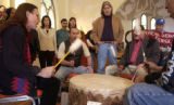 (Denver, Colo., 1/25/05) - Members of the Transform Columbus Day Alliance, sing a song of thanks,...