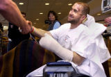 (Denver, Colo., 1/25/05- Jamin Camp (right) shakes hands with Denver Police Sgt. Greg Jones (left...