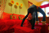(Denver, Colo., January 27, 2005) Fourteen-year-old Jessica Laub doing a backbend in ottomans in...