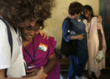 (1/26/05, Pondicherry, India)  Kitty Potter hugs S. Shanthi to the left while Annie Smith hugs...