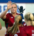 USA Olympic softball pitcher Jenny Finch gets high fives from her teammates between inning of an...
