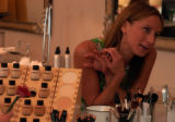 (BOULDER, Colo., July 13, 2004) Jennifer Wert, owner, watches the process of make up...