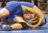 [(Denver, CO, Shot on: 2/10/05)] The head of EADS's Brandon Cordova, Jr.,is squeezed by defending...