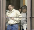 Denver, Colo.-February 11,2005- Juan Pablo Beltran(right), defendant in phony driver's license...