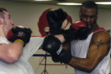 Steve Steinbeiss of Phoenix scores a hit on Michael Westbrook while sparring at Combat Sports in...