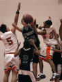(DENVER, Colo., January 26, 2005)  Cory Reiter, center, battles for a rebound with Franciso Chavez...
