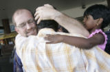 (1/28/05, Chennai, India) Scott Tidwell, from Littleton, gives Samson George a big hug good-bye...