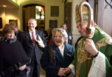 (DENVER, CO. JANUARY 30, 2005) Bishop Gomez (right) says his farewells to parishioners after his...