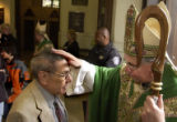 (DENVER, CO. JANUARY 30, 2005) Bishop Gomez blesses Joe Lopez, after his final Sunday Mass, as he...