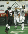 SPECIAL TO THE ROCKY MOUNTAIN NEWS-Colorado Crush quarterback John Dutton, right, throws downfield...