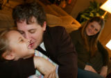 photo/BENJAMIN KRAIN 1-30-05 Paul Kelly and his fiance Courtney Pierce, right, visit with his...