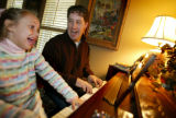 photo/BENJAMIN KRAIN 1-30-05 Paul Kelly visits with his 6-year-old daughter Hannah during a ...