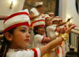 (DENVER, COLORADO, January 30, 2005) Arushi Raval, 7, left, poses for parents before her Sattriya...