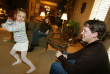 photo/BENJAMIN KRAIN 1-30-05 Paul Kelly and his fiance Courtney Pierce, center, visit with Kelly's...