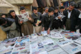 NYT12 - (NYT12) IRBIL, Iraq -- Feb. 14, 2005 -- IRAQ-1 -- Iraqi Kurds pick up newspapers featuring...