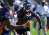 (DOVE VALLEY, Co., SHOT 7/29/2004) Denver Broncos' running back Mike Anderson (#38) carries the...