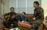 (PEYTON,  Colo., January 28, 2005) Michael plays a personal song he wrote while David,9, listens...