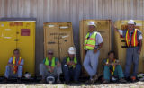 (Golden, CO., JULY 15, 2004) Workers involved in the clean-up of Rocky Flats watch a ceremony...