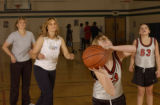 (Aurora, COLO.  February 9, 2005) Judy Lutkin, second from left, plays basketball with her family,...