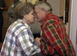 (LOVELAND, Colo., February 2, 2005) Ruth and Harold Porter, Loveland, share a quick lovetap as...